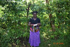 The Water Project: Shikhombero Community, Atondola Spring -  Serilah Shows Her Mask