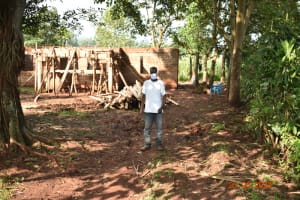 The Water Project: Busichula Community, Marko Spring -  Simon Mulongo Outside His Home