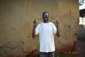 The Water Project: Busichula Community, Marko Spring -  Simon Mulongo Shows His Mask