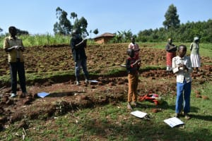 The Water Project: Bumavi Community, Shoso Mwoga Spring -  Following Handwashing Steps