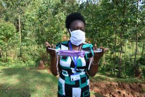 The Water Project: Bumavi Community, Shoso Mwoga Spring -  Mask Making