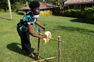 The Water Project: Bumavi Community, Shoso Mwoga Spring -  Setting Up A Handwashing Station