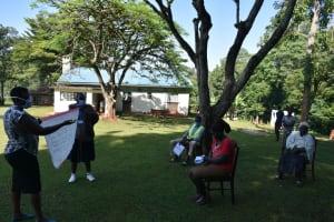 The Water Project: Shitaho Community, Andrea Kong'o Spring -  Use Of Reminder Charts At The Training