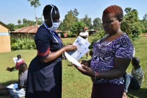 The Water Project: Wamuhila Community, Isabwa Spring -  Distributing Handouts At The Training