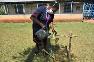 The Water Project: Wamuhila Community, Isabwa Spring -  Filling Handwashing Station With Water