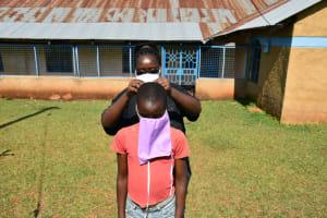 The Water Project: Wamuhila Community, Isabwa Spring -  Training On Proper Mask Wearing