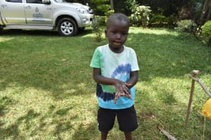 The Water Project:  Elvis Showing Handwashing Steps