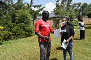 The Water Project:  Explaining Pamphlet To Participant