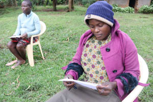 The Water Project: Murumba Community, Muyokani Spring -  Reading Covid Informational Pamphlet