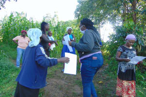 The Water Project: Handidi Community, Malezi Spring -  Ms Patience Njeri Issuing The Handouts