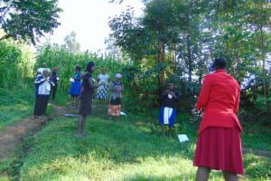 The Water Project: Handidi Community, Malezi Spring -  Ms Wagaka Leading Mask Making Tutorial