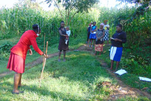 The Water Project: Handidi Community, Malezi Spring -  Demonstating How To Make A Handwashing Station
