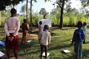 The Water Project: Bukhakunga Community, Indiatsi Omukitsa Spring -  Using Charts At The Training
