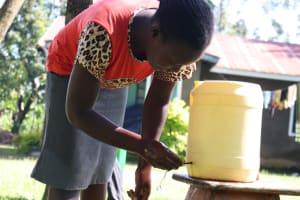 The Water Project: Tsivaka Community, Wefwafwa Spring -  Using A Setup Handwashing Point