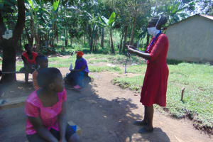 The Water Project: Ebung'ayo Community, Wycliffe Spring -  Community Members Listening In Closely
