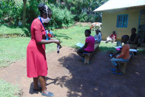 The Water Project: Ebung'ayo Community, Wycliffe Spring -  Showing How To Make A Mask