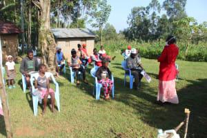 The Water Project: Shiamboko Community, Oluchinji Spring -  Trainer Kayi Leading A Session