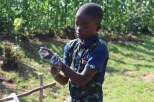 The Water Project: Shiamboko Community, Oluchinji Spring -  Young Man Was Very Sharp And Showed Good Handwashing Technique