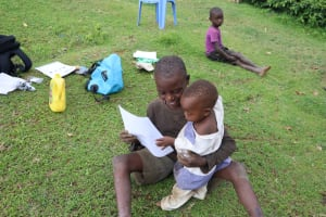 The Water Project: Mumuli Community, Shalolwa Spring -  Small Man Tried Reading Through The Manual