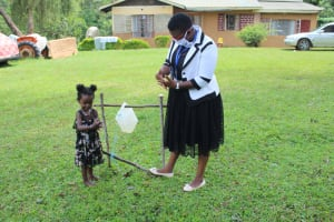 The Water Project: Lutonyi Community, Shihachi Spring -  Little Girl Was Not Going To Be Left Behind In Handwashing