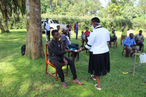 The Water Project: Lutonyi Community, Shihachi Spring -  Ms Chelagat Issuing Covid Informational Leaflets