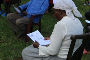 The Water Project: Lutonyi Community, Shihachi Spring -  Reading The Informational Leaflet
