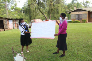 The Water Project: Lutonyi Community, Shihachi Spring -  Reviewing The Prevention Reminders Chart