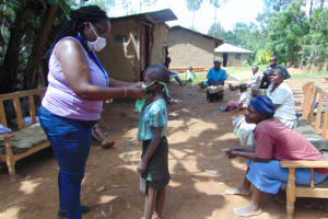 The Water Project: Handidi Community, Matunda Spring -  A Complete Mask Awarded To A Child