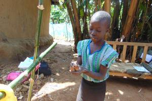 The Water Project: Handidi Community, Matunda Spring -  A Girl Washing Her Hands