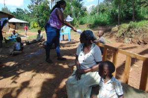 The Water Project: Handidi Community, Matunda Spring -  Ms Njeri Handing Out The Training Manuals