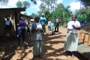 The Water Project: Handidi Community, Matunda Spring -  Participants Pose With Training Manuals After Training