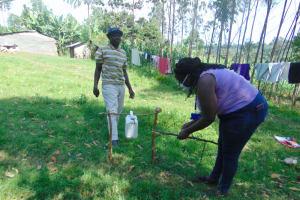 The Water Project: Mukhuyu Community, Shikhanga Spring -  Demonstrating Handwashing