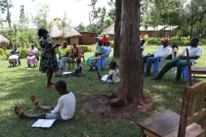 The Water Project: Ematiha Community, Ayubu Spring -  Team Leader Catherine Addressing The Group