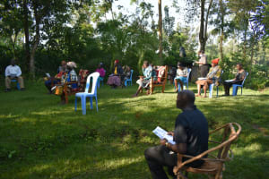 The Water Project: Shitoto Community, Laurence Spring -  Community Members Listen To The Facilitator