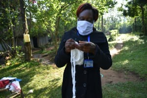 The Water Project: Shitoto Community, Laurence Spring -  The Facilitator Sewing A Mask
