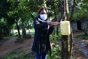 The Water Project: Shitoto Community, Laurence Spring -  Facilitator Demonstrating Handwashing Procedure