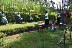 The Water Project: Shikoti Community, Amboka Spring -  Ms Betty Addressing Community Members