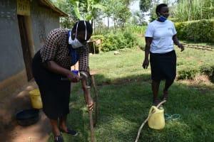 The Water Project: Shikoti Community, Amboka Spring -  Building A Tippy Tap Handwashing Station