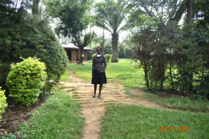 The Water Project: Eshiakhulo Community, Asman Sumba Spring -  Mercy Ogonga Outside Her Home
