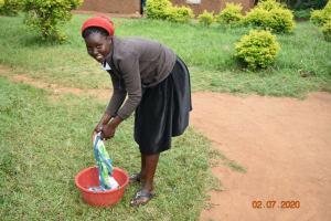 The Water Project: Eshiakhulo Community, Asman Sumba Spring -  Mercy Ogonga Washing Using Water Fromasman Sumba Spring