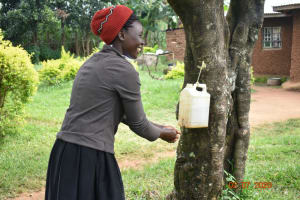 The Water Project: Eshiakhulo Community, Asman Sumba Spring -  Mercy Washes Her Hands