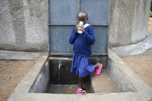 The Water Project: Mutiva Primary School -  Drinking Water From The Water Point