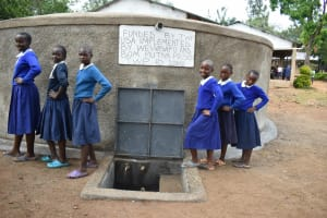 The Water Project: Mutiva Primary School -  Girls Posing At The Water Point