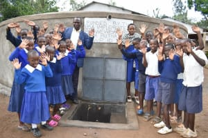 The Water Project: Mutiva Primary School -  Posing At The Water Point With Water Flowing