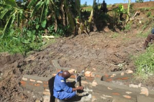 The Water Project: Mahira Community, Litinyi Spring -  Pipe Setting