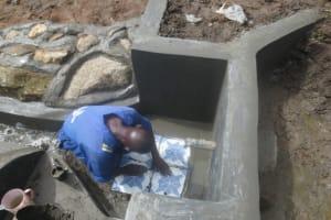 The Water Project: Mahira Community, Litinyi Spring -  Tile Setting