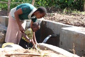 The Water Project: Mahira Community, Litinyi Spring -  Like Mother Like Son