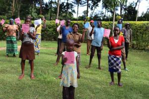The Water Project: Harambee Community, Elijah Kwalanda Spring -  Participants Pose With Training Manuals