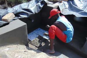 The Water Project: Mukhuyu Community, Chisombe Spring -  Tile Setting