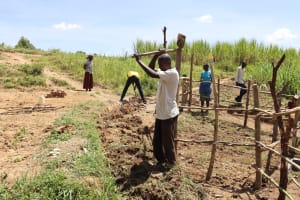 The Water Project: Mukhuyu Community, Chisombe Spring -  Community Member Digging A Cut Off Drainage